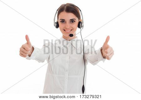 Young business woman in headset reaches her hands forward and shows two thumbs up isolated on white background.