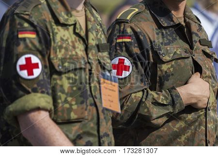 BERLIN / GERMANY - JUNE 3 2016: two german army soldiers with a red cross brassard