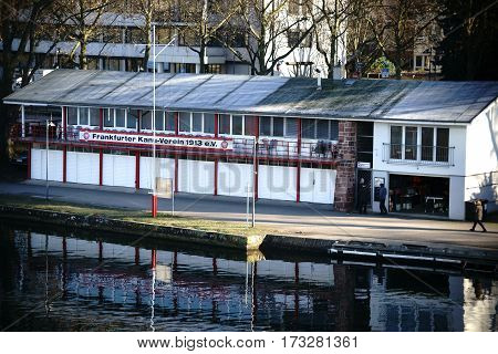 FRANKFURT, GERMANY - JANUARY 05: Pedestrians walk along the river promenade and pass the Frankfurt Canoe Club on January 05, 2017 in Frankfurt.