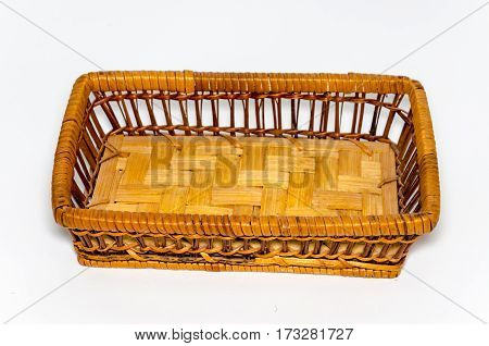 Rectangular wicker basket brown color on a white background. Handmade