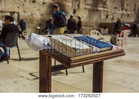 Passover Jewish. Jerusalem, Israel. Western Wall also known as Wailing Wall or Kotel. The Torah Book in the foreground.