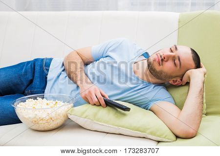 Man fell asleep while watching television at his home.