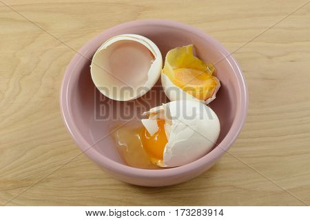 Freezer burned frozen rotten eggs in bowl