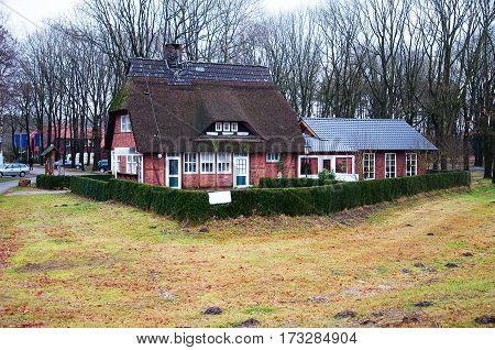 The building is on the road in rural areas of Germany. House as an example of German architecture.