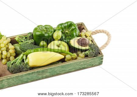 Set Of Different Green Fresh Raw Vegetables And Fruits In The Wooden Tray