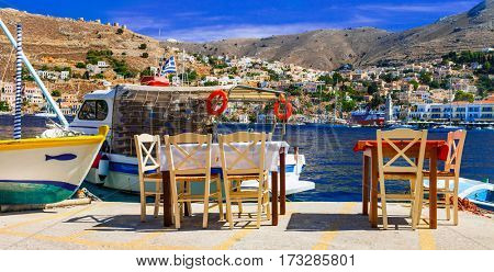 Traditional Greece - small street fish tavernas in Symi island,