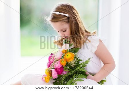 Little Girl With Flower Bouquet