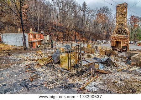 GATLINBURG TENNESSEE/USA - DECEMBER 14 2016: A tourist cabin that has been burned to the ground by a forest fire in Gatlinburg in late 2016.