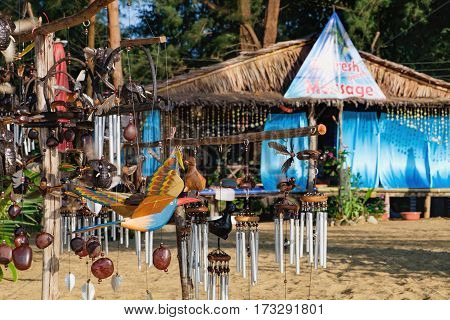 Handmade Thai wooden souvenirs wind bells for sale on the Nang Thong Beach Khao Lak Thailand. Feng Shui chimes hang outside the house for protection and good luck