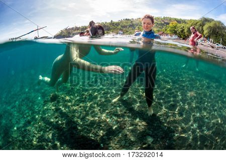 Underwater shot of free divers training in the sea