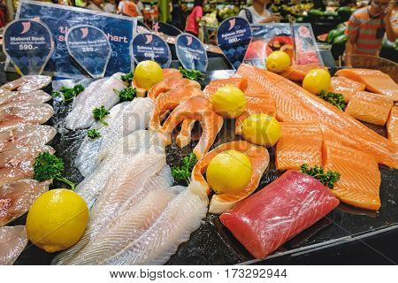 Bangkok,Thailand - January 10, 2016: Fillets and steaks of mackerel pangasius salmon tuna with price tags for sale in Big C Supercenter on Ratchadamri Road, Bangkok, Thailand.
