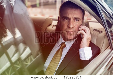 Photo Gradient Style with Businessman Talking Using Phone Car Inside