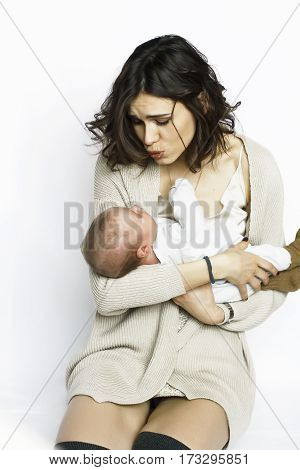 a child in the arms of his mother. Mom dressed fashionably. silk jersey. it soothes the baby.