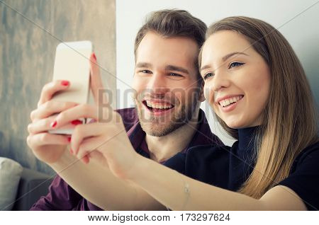 Young Couple Taking A Selfie Photo