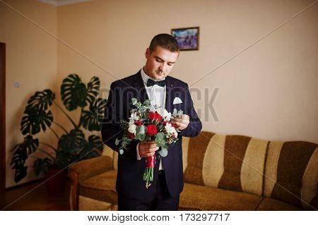 Groom With Wedding Bouquet At His Room At Morning Day.