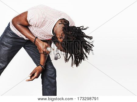 young handsome african american boy singing emotional with microphone isolated on white background, in motion gesturing smiling, lifestyle people concept close up