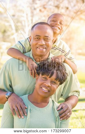 Beautiful Happy African American Family Portrait Outdoors At The Park.