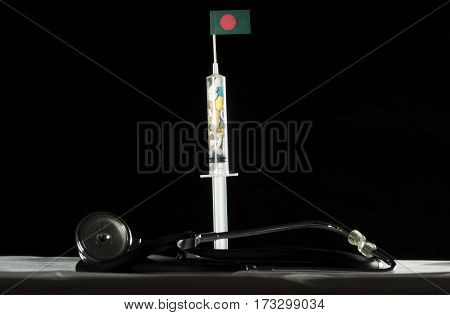 Stethoscope And Syringe Filled With Drugs Injecting The Bangladeshi Flag On A Black Background