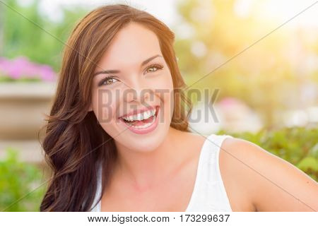Pretty Mixed Race Girl Portrait Outdoors at the Park.