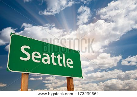 Seattle Green Road Sign Over Dramatic Clouds and Sky.
