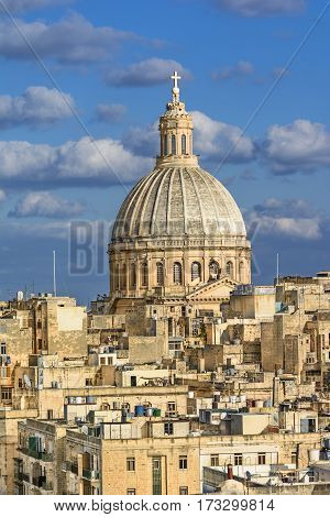 Valetta overview. View of a church dome over the roofs of Valetta
