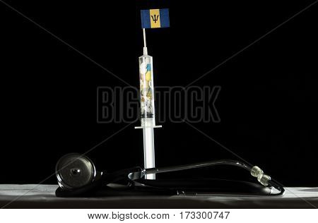 Stethoscope And Syringe Filled With Drugs Injecting The Barbadian Flag On A Black Background