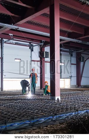 St.Petersburg, Russia - 20 february 2017: Welding and assembly works under construction inside a large warehouse