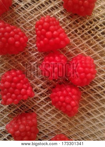 Raspberries - it is one of the most delicious and desirable summer berries ripe berry sweet dessert on abackgroundred on mantle