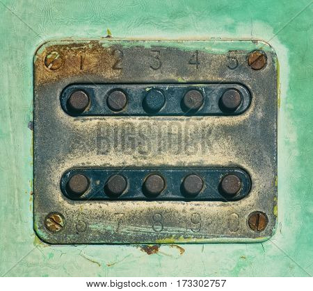 An old combination lock on the iron door closeup