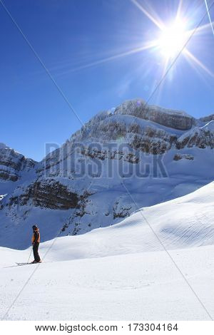 Skier Enjoying The Silence Of The Mountain In A Sunny Day, Spain