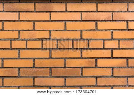 Red brick wall with horizontal masonry. Background