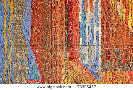 Colorful stone mosaic on the wall of colorful tiles. Backgrounds and textures