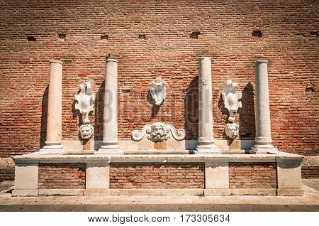 Ancient stone fountain depicting the god Neptune from whose mouth the water came out.