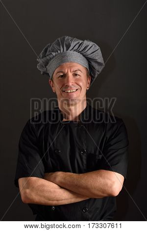 Portrait of a chef on black background