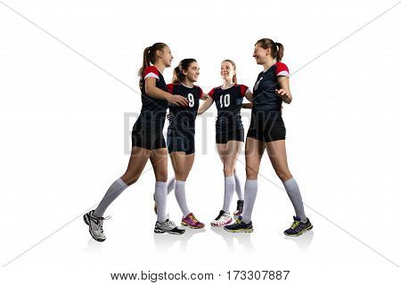 Female volleyball team celebrating a point isolated on white background