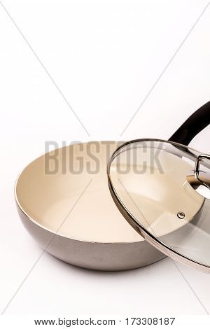 Empty Ceramic Frying Pan With A Lid On A White Background