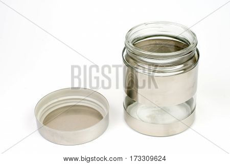 Glass Jar In Metal Over White Background