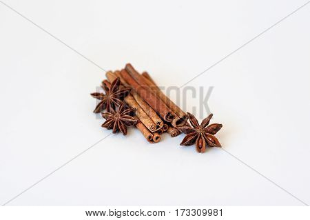 Two cinnamon sticks and star anise isolated on white background