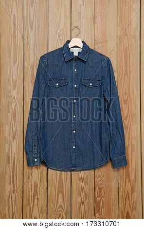 jeans shirt –wooden background