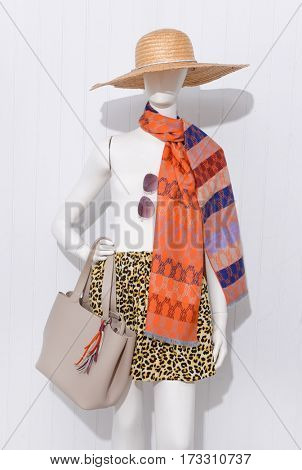 female clothing with hat and scarf ,sunglasses,,bag,on mannequin