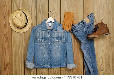 Set of Jeans shirt with Blue jeans trousers ,hat,gloves - wooden background