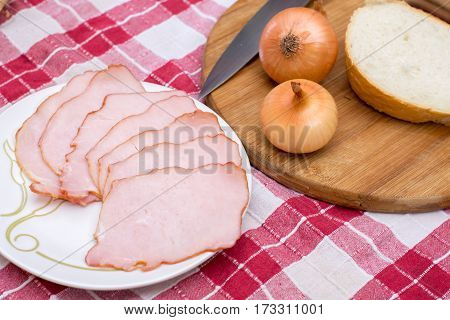 Cured Meat Served With Onions On The Cutting Board