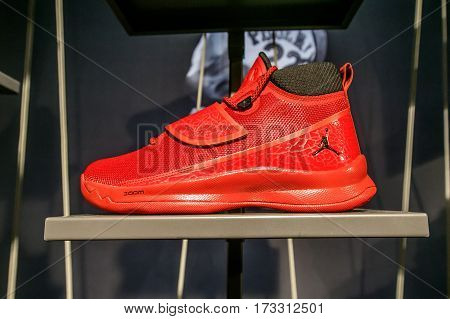 New York February 21 2017: A red Air Jordan basketball sneaker for sale in the NBA store in Manhattan.