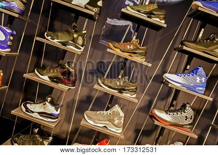 New York February 21 2017: Air Jordan and Under Armour basketball sneakers on sale in the NBA store in Manhattan.