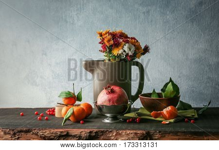 Assortment of fruits with flowers on wooden table