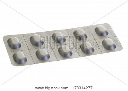 Pills in blister isolated on bright background