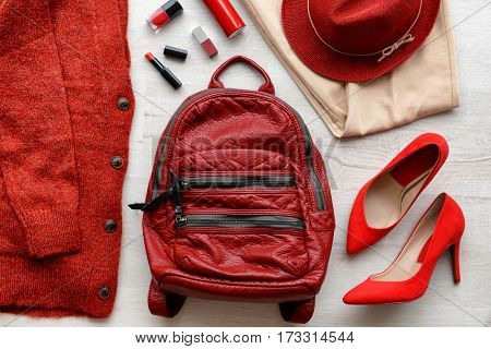 Stylish women clothing and accessories on wooden background