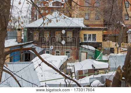 Kazan, Russia, 17 february 2017: courtyard of traditional russian old wooden house, winter snow, wide angle