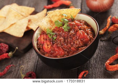 Mexican chili con carne, ground beef stew served with tortilla chips