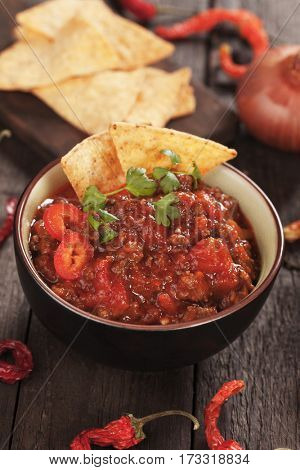 Chili con carne, mexican beef stew served with tortilla chips